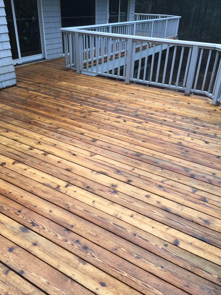 Dependable Deck Cleaning For Your Michigan Property Your deck is a considerable investment. It's also a smart and comfortable way to extend your living space. You enjoy the outdoors, family time, gatherings, parties, and cook-outs on your deck. It's important to keep it safe, hygienic, and visually appealing for optimum enjoyment. Because your deck is exposed to outdoor elements year-round, debris, dirt, and algae can build up quickly. This accumulation mars the beauty of your outdoor recreational space. It also presents safety hazards - slips, trips, and falls. That's why regular deck washing is an essential part of your deck maintenance regimen. Why Hire Professional Cleaners? Your deck is outdoors, and you own a garden hose. Why do you need to hire a cleaning company? Well, a hose isn't going to cut it on mold, mildew, algae, and built-up dirt and sludge. You need pressurized water to blast away that grime. But before you rush out and rent a pressure washer, be sure you understand all the variations of this sensitive, yet powerful equipment. You must select the right pressure/pump psi, use the proper pressure nozzles, and apply a constant, steady hand while cleaning. Wood, concrete, and painted surfaces are all washed differently. The wrong choices and applications can cause damage. You can mar the finish, erode paint, disfigure the wood, mark up and etch the surfaces, and do other damage. Applying the wrong cleaning chemicals and detergents carry potential dangers, as well. In addition to the damage they might do to your deck, they can harm your pets and vegetation. At the very least, they simply won't do the job. Avoid all these problems and secure a clean deck with the skilled exterior ProWash cleaners at Roof Renew of Michigan! Thorough Deck Cleaning Services Our team is prepared to clean with the equipment, cleaning solutions, and skill you desire. Our cleaners are prompt, courteous, professional, and thorough. We respect your property, privacy, and time. We